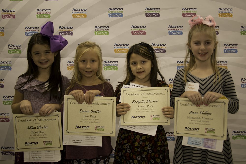 Group of 4 award winners holding their certificate