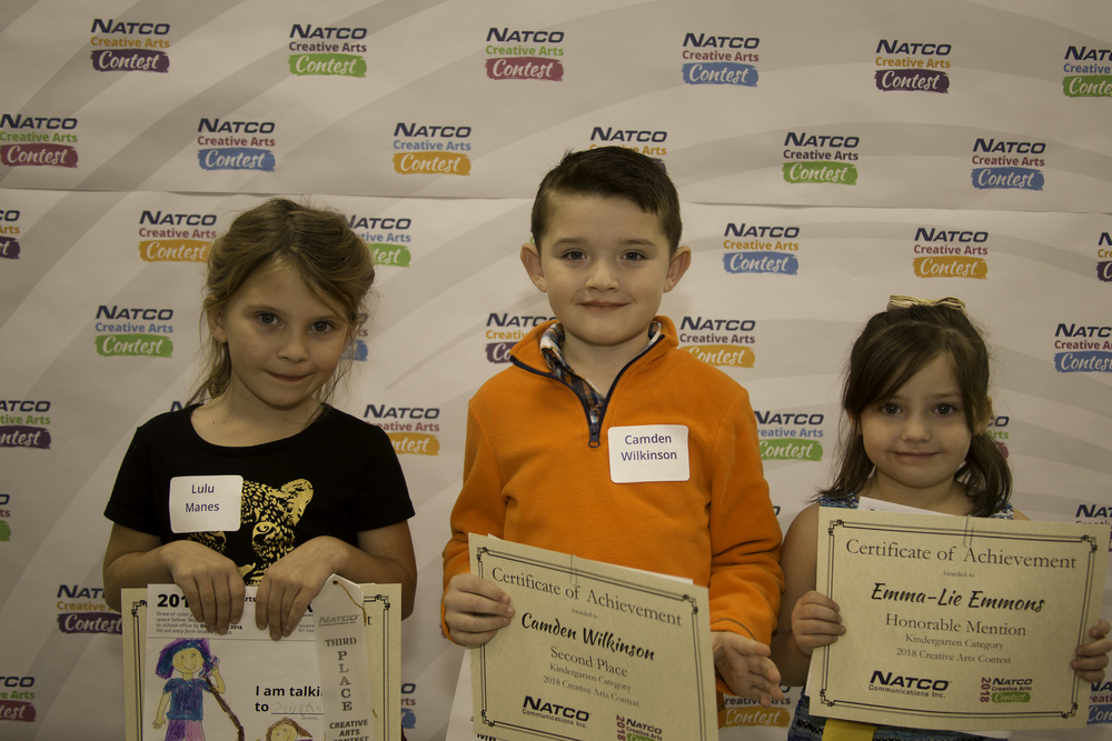 3 children holding award certificate