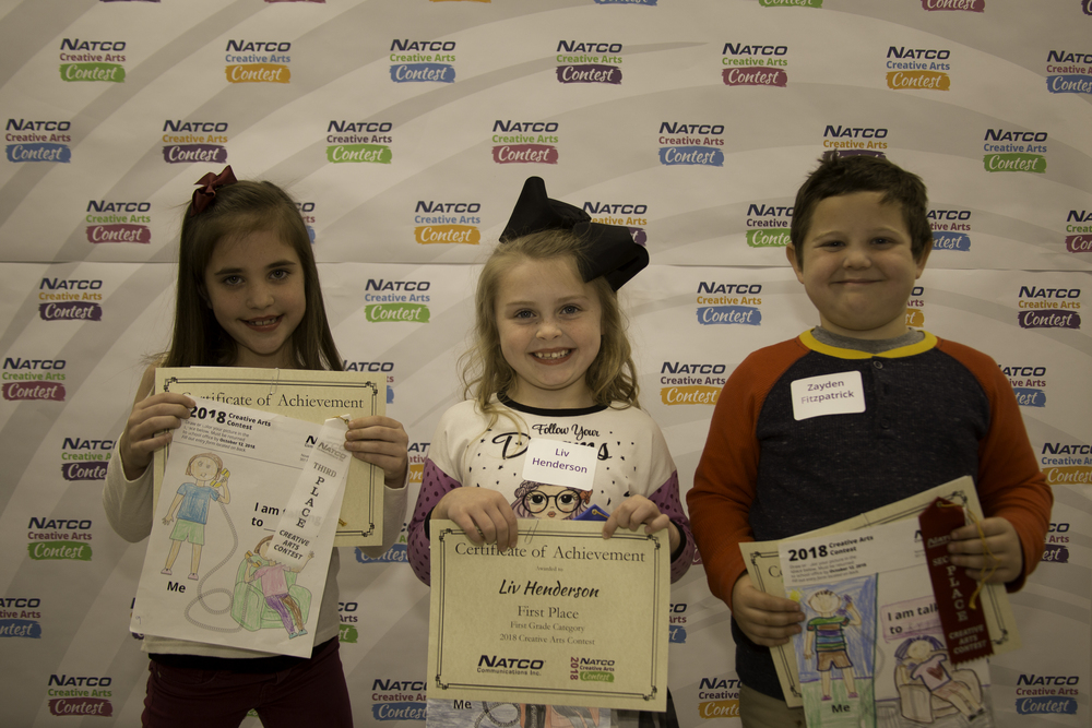 3 children holding certificates from natco